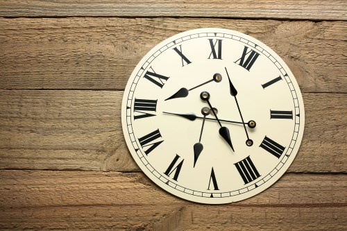 Clock on Wooden Background